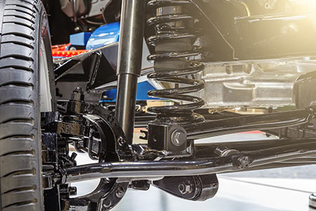 New front axle with custom suspension and shock absorber to improve car performance